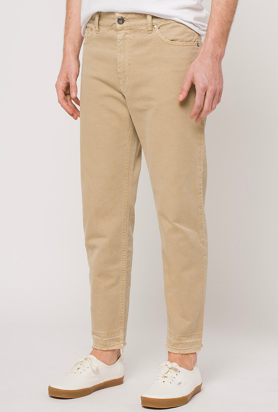 cropped beige trousers